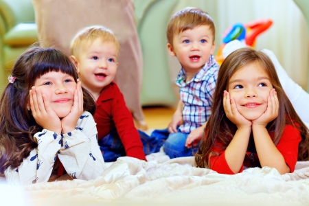 group of attentive kids in nursery room photo