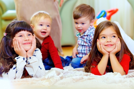 group of attentive kids in nursery room