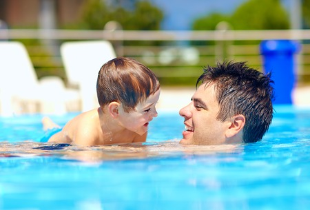 happy family in summer pool