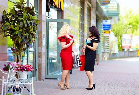 plus size: happy plus size women shopping, talking on the street