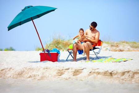 happy family on summer beach photo