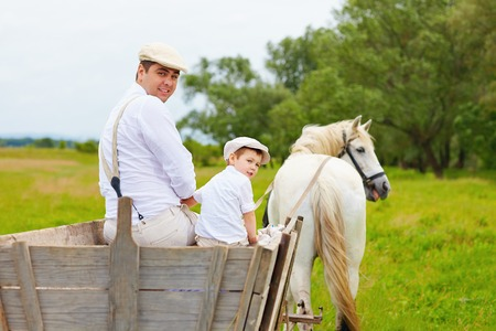 horse and carriage: funny photo of farmer family and horse looking back