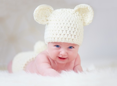 beautiful smiling baby in cute hat photo