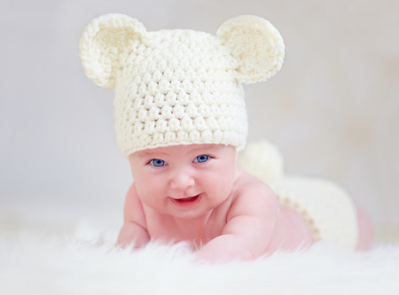 beautiful smiling baby in cute hat