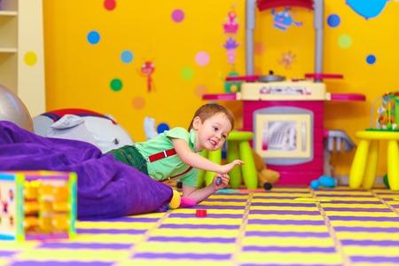 excited kid having fun in kindergarten photo