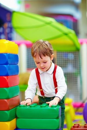 kid building blocks in kindergarten photo
