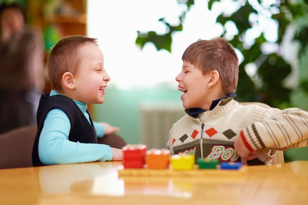 cognitive: relation between kids with disabilities in preschool Stock Photo