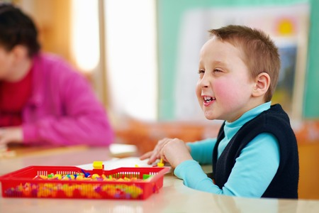 cerebral palsy: cognitive development of kids with disabilities Stock Photo