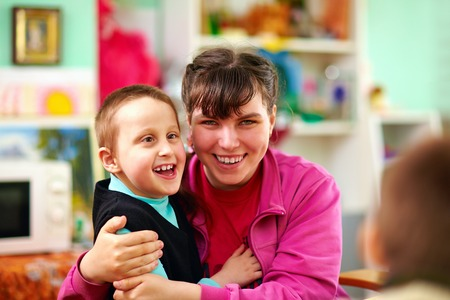cerebral palsy: cheerful kids with disabilities in rehabilitation center