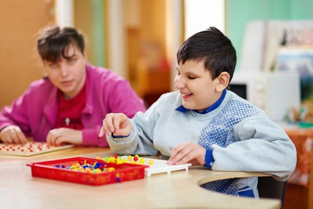 cognitive: cognitive development of kids with disabilities Stock Photo