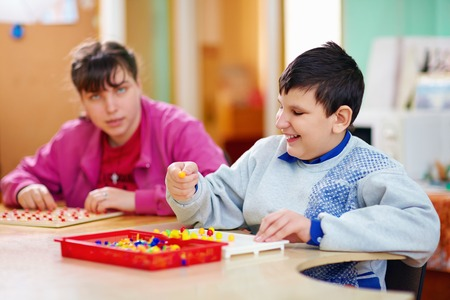 cerebral: cognitive development of kids with disabilities Stock Photo