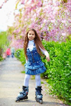 rollerblade: pretty girl rollerblading on spring street Stock Photo