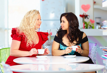plus size women sitting in cafe Stock Photo