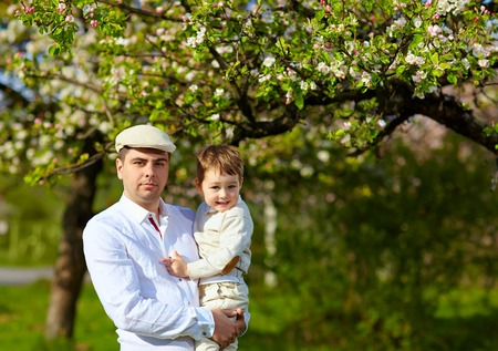 cary: happy father and son in spring garden
