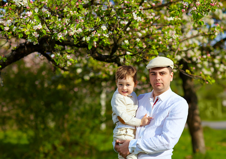 happy father and son in spring garden