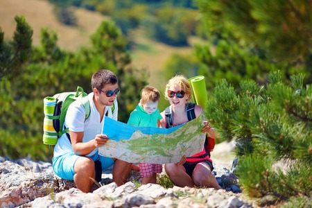 family in mountains discussing the route photo