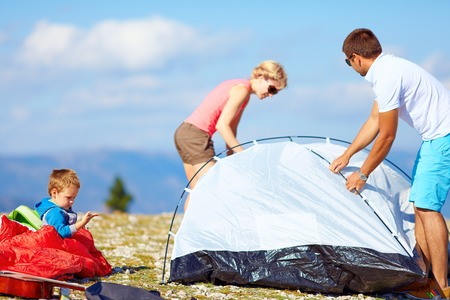 family set up a camp in mountains, active lifestyle Stock Photo