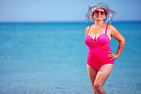beautiful adult woman on summer beach Stock Photo