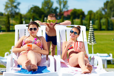 sunbed: group of teenage kids enjoying summer in water park