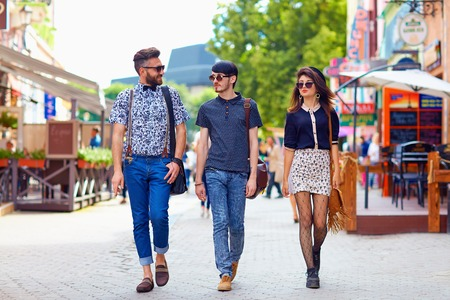young fellow: stylish friends walking the city street