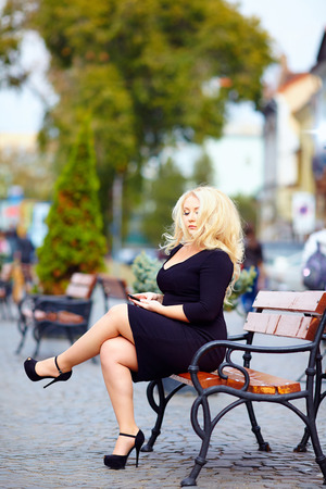beautiful overweight woman in the city photo