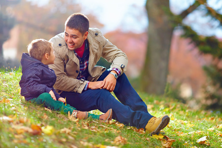 happy father and son having fun in autumn park Stock Photo
