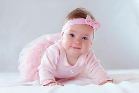 pretty baby girl in pink dress