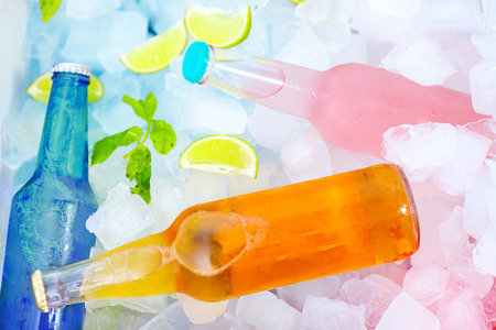 chilled colorful beverages in ice box. summer party photo