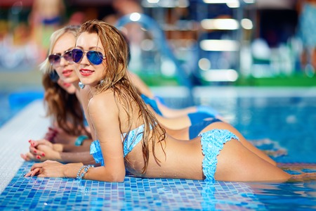 recreate: seductive girls enjoy summer in pool