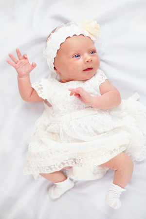 3 month: beautiful baby girl in white dress, three weeks old