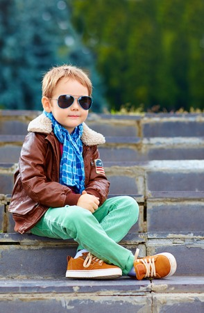 cute stylish boy in leather jacket and gum shoes photo