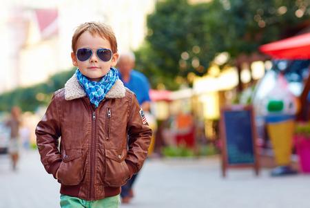 stylish boy: stylish kid walking city street, autumn fashion