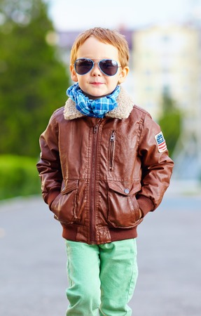 cool young kid walking the street photo