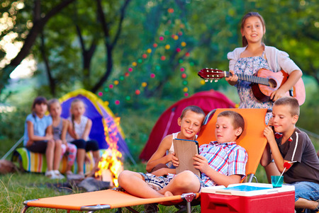 group of happy kids on summer picnic photo