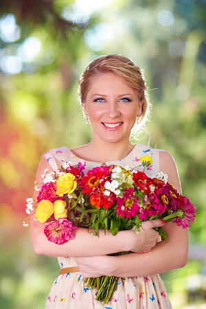 armful: pretty lady with armful of wildflowers Stock Photo