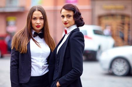 croupier: beautiful girls in black suits