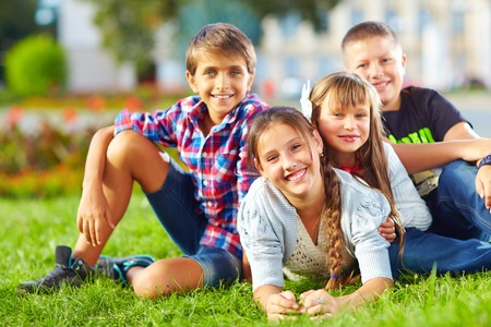 young fellow: happy schoolkids in the park Stock Photo