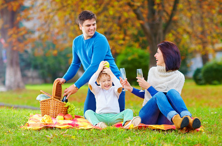 happy moment: laid-back moment of family on autumn picnic