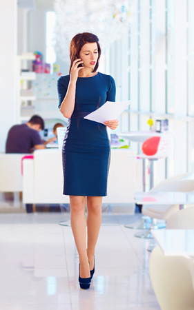 dress code: confident business woman busy with work Stock Photo