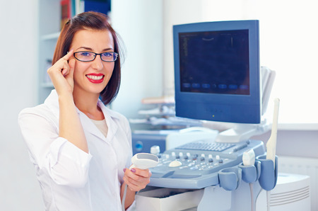 cheerful female doctor with ultrasound sensor Stockfoto