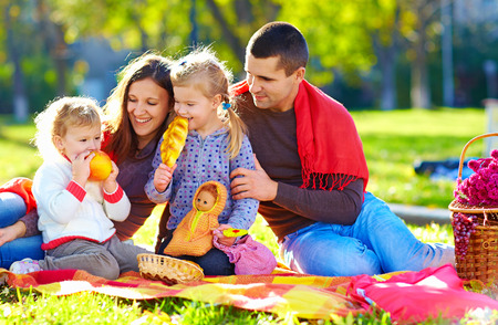 happy family on autumn picnic in park photo