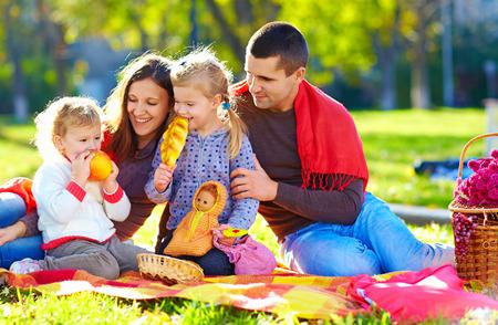 picnic blanket: happy family on autumn picnic in park Stock Photo