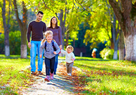 walk in: happy family on walk in park Stock Photo