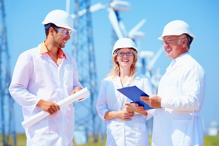wind power plant: group of engineers on wind power station Stock Photo