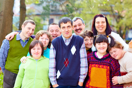 group of happy people with disabilities Stock Photo