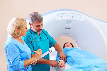 ct scan: medical staff preparing patient to CT scanner procedure Stock Photo