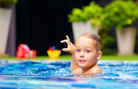 little boy swimming: cute little boy swimming on pool