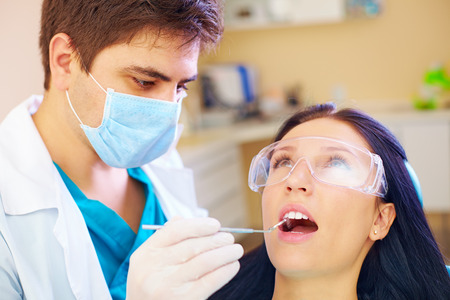 preventive: young woman visiting dentist doctor in clinic