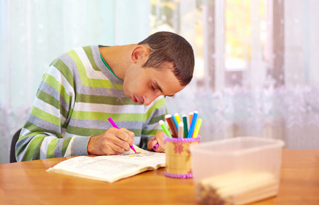 young adult man engages in self study, in rehabilitation center Stockfoto