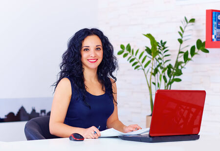 dress code: smiling woman working in office
